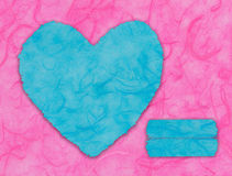 Blue heart shape on pink Stock Photos