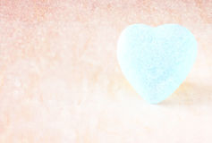 Blue heart shape on wood background Stock Photography