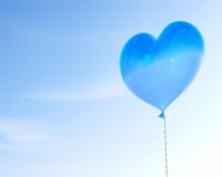 Blue heart shaped balloon. Floating in the air 3D rendering Royalty Free Stock Photo
