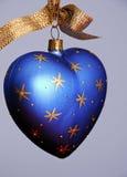 Blue Heart shaped Christmas Tree Ornament. Blue Heart Christmas Ornament on gray field Stock Photos
