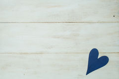 Blue heart on a white background, wood painted Greek blue stock image