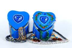Blue hearts. Two blue heart shaped treasure chests with jewelry isolated on white background Royalty Free Stock Photo