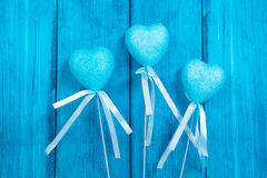 Blue hearts on a blue background. Blue hearts on a blue wooden background Stock Photo