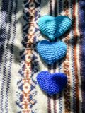 Blue hearts on  Christmas sweater Royalty Free Stock Images