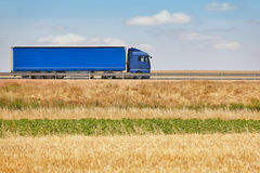Blue heavy truck on the road. Delivery cargo logistic Stock Photography
