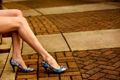 Blue heels. Caucasian woman wearing blue heels against a stone background Royalty Free Stock Photo