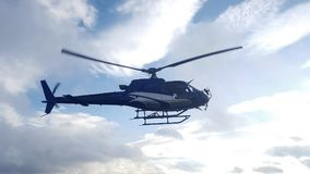 Blue helicopter flying Royalty Free Stock Photos