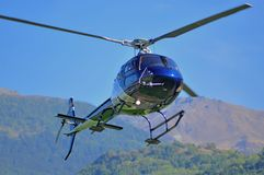 Blue helicopter landing Stock Images