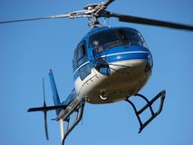 Blue helicopter on blue sky Stock Images