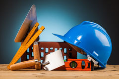 Blue helmet and builder tools Royalty Free Stock Image