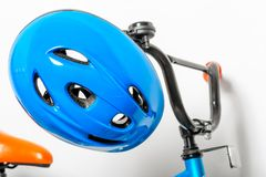 Blue helmet for children on the handlebars of a children`s bicyc. Le close-up Royalty Free Stock Photos