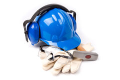 Blue helmet with earmuffs and gloves and your eyes with a hammer Royalty Free Stock Photos