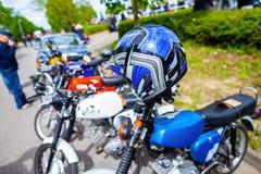 Blue helmet hangs on motorbike stock photos