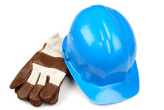 Blue helmet and working gloves Royalty Free Stock Image