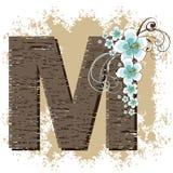Blue hibiscus alphabet M. Blue hibiscus grunge vintage alphabet M Royalty Free Stock Photography