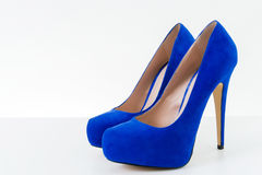 Blue high heel shoes. Pair of the blue high heel shoes on a white background stock images