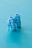Blue high heeled doll shoes Stock Photo