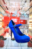 Blue high heeled shoe Stock Images