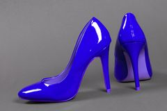 Blue high heels shoes on gray background Royalty Free Stock Images