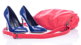 Blue high heels shoes with red pink handbag Stock Photography