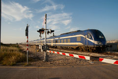 Blue high speed passenger train Royalty Free Stock Image