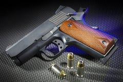 Blue highlighted handgun and ammo Stock Photos