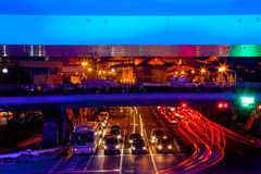 Blue Highway Street Traffic Jingan Temple Shanghai. Blue Highway Street Traffic Cars and Light Trails Jingan Temple at Night in Central Shanghai, China Stock Image