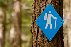 Blue Hiking Trail Marker. Hiking trail marker sign on tree stock images