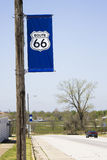 Blue Historic Route 66 Sign. Blue Route 66 sign designating the road a historic byway. A series of banners along Route 66 in Carterville, Missouri Stock Image
