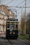 Blue historical streetcar driving at the lange vijverberg in The. Hague as museum Stock Photos