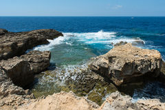 Blue hole and the collapsed Azure window. Gozo, Malta. Rocky coastline and sea. Blue hole and the collapsed Azure window in Dwejra Bay, Gozo, Malta Stock Images