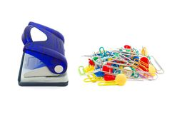Blue hole puncher with paperclips. Photo of the Blue hole puncher with paperclips on white background Stock Image