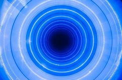 A blue hole is a well, illuminated. Abstract circle. Royalty Free Stock Images