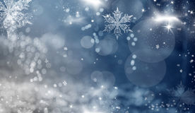 Blue holiday abstract background with stars and snowflakes Stock Images