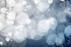 Blue holiday abstract background with stars and snowflakes Stock Image