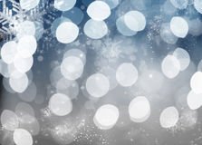 Blue holiday abstract background with stars and snowflakes Royalty Free Stock Image
