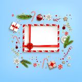 Blue holiday backdrop and copy space. Flat lay, top view Christmas composition with fir tree branches on light holiday background. Natural design elements Stock Images