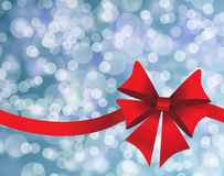 Blue holiday's background with red bow Royalty Free Stock Images