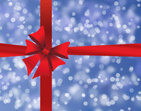 Blue holiday's background with red bow Royalty Free Stock Photography