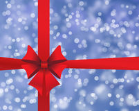 Blue holiday's background with red bow Stock Image