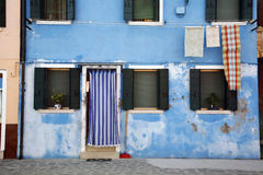 Blue home Burano. Colorful house on the island of Burano in the Venetian lagoon - Italy Royalty Free Stock Photo