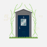 Blue home door with grass and ivy Stock Photos