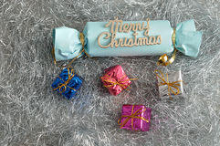 A blue home made Christmas cracker with shiny gifts Royalty Free Stock Photo