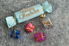 A blue home made Christmas cracker with shiny gifts Stock Photos