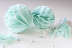Blue honeycombs with paper trumpets on white table royalty free stock photo