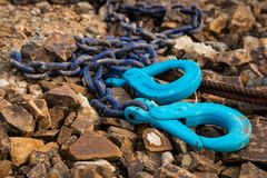 Blue hooks and Chain. Blue color chain with two hooks Stock Photo