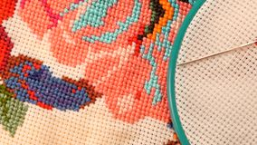 Blue hoop with thread and bright embroidery stock video footage
