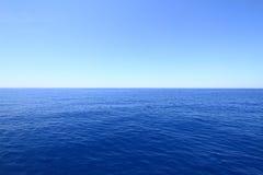 Blue horizon. Blue sea and sky horizon royalty free stock photography