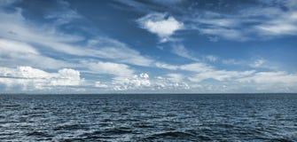 Blue Horizon. Between the ocean and beautiful blue cloudy sky stock photos