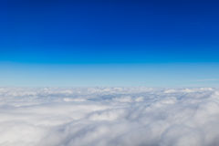 Blue horizon and white clouds Royalty Free Stock Images
